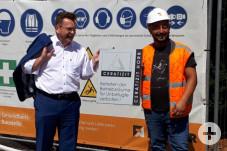 Bürgermeister Zimmermann und Bauleiter